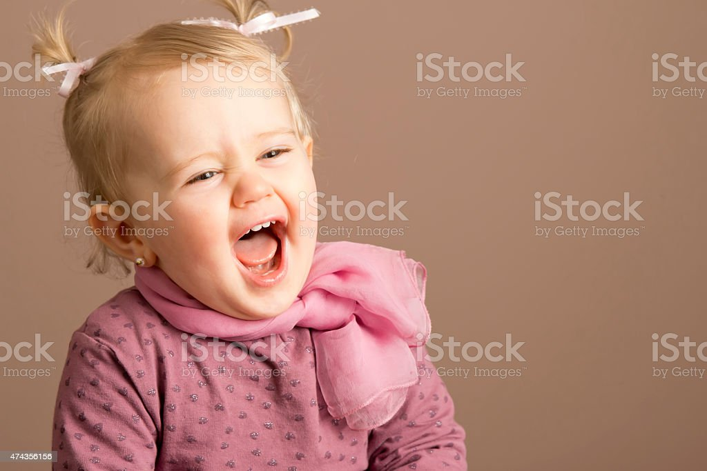 Baby girl laughing uproariously stock photo