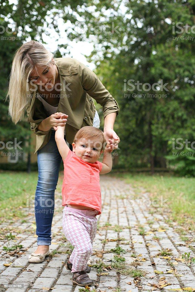 Baby girl learning walking. stock photo