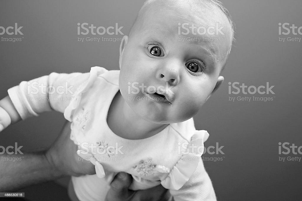 Baby Girl Looking at Camera stock photo