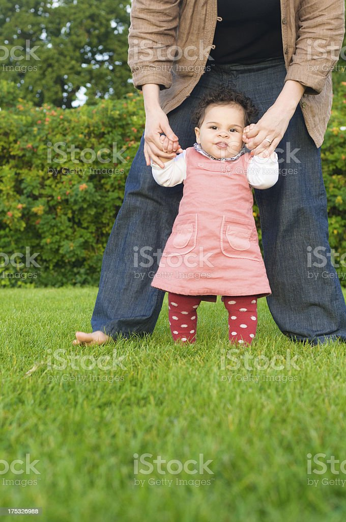 Baby Girl Making  First Steps With Her Mother royalty-free stock photo