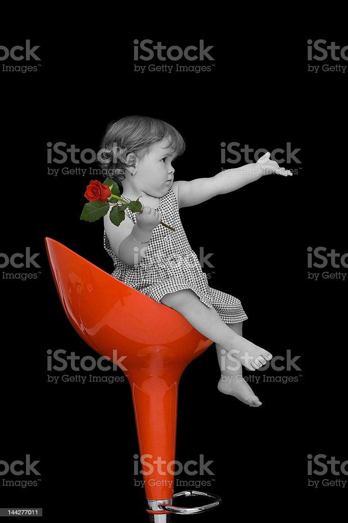 Baby girl on a stylish stool royalty-free stock photo