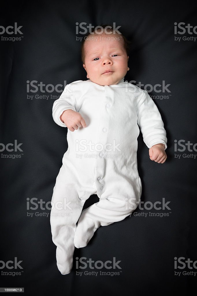Baby girl on black background stock photo