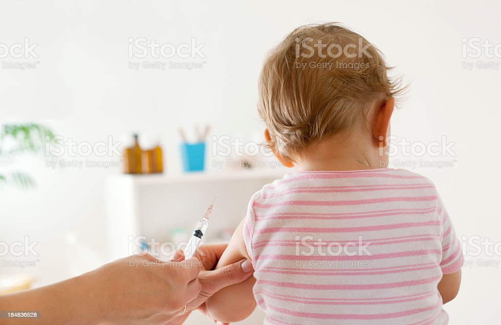 Baby Girl Patient Receiving Vaccine at doctor's office stock photo