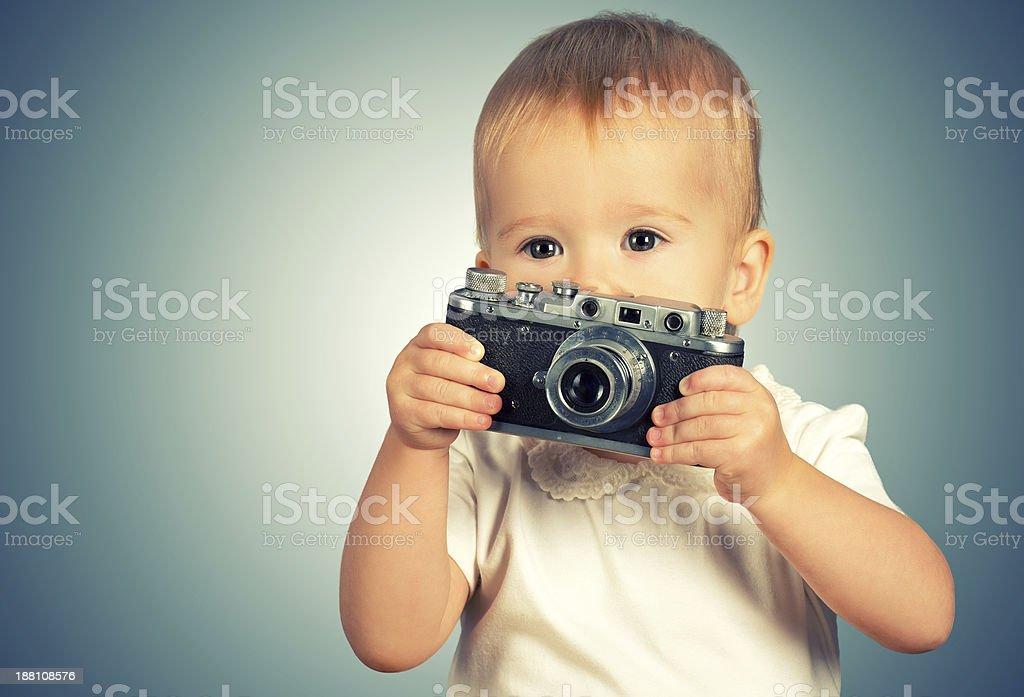 baby girl photographer with retro camera royalty-free stock photo