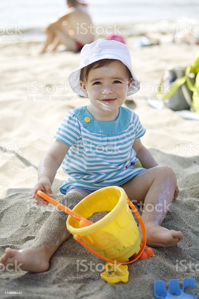 baby girl playing in the sand royalty-free stock photo