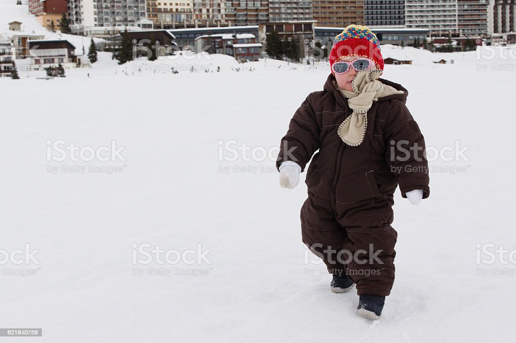 Baby girl playing in the snow stock photo
