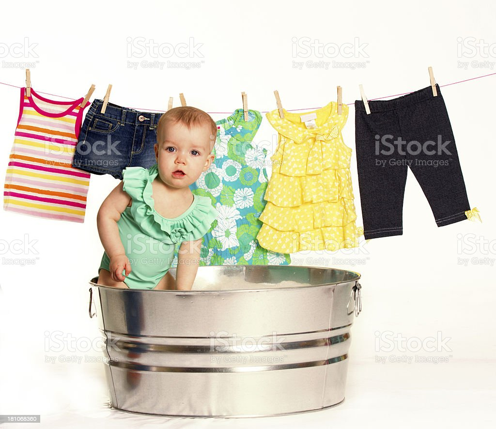Baby girl playing in tub royalty-free stock photo