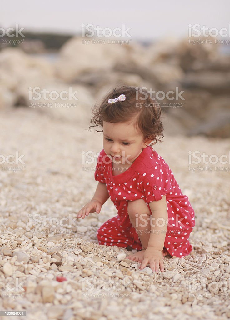 baby girl playing on the beach royalty-free stock photo