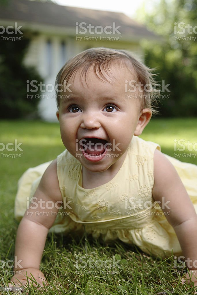 Baby girl playing outdoors royalty-free stock photo