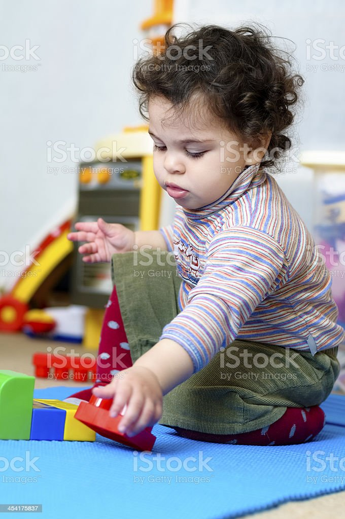 Baby Girl Playing With Plastic Building Blocks royalty-free stock photo