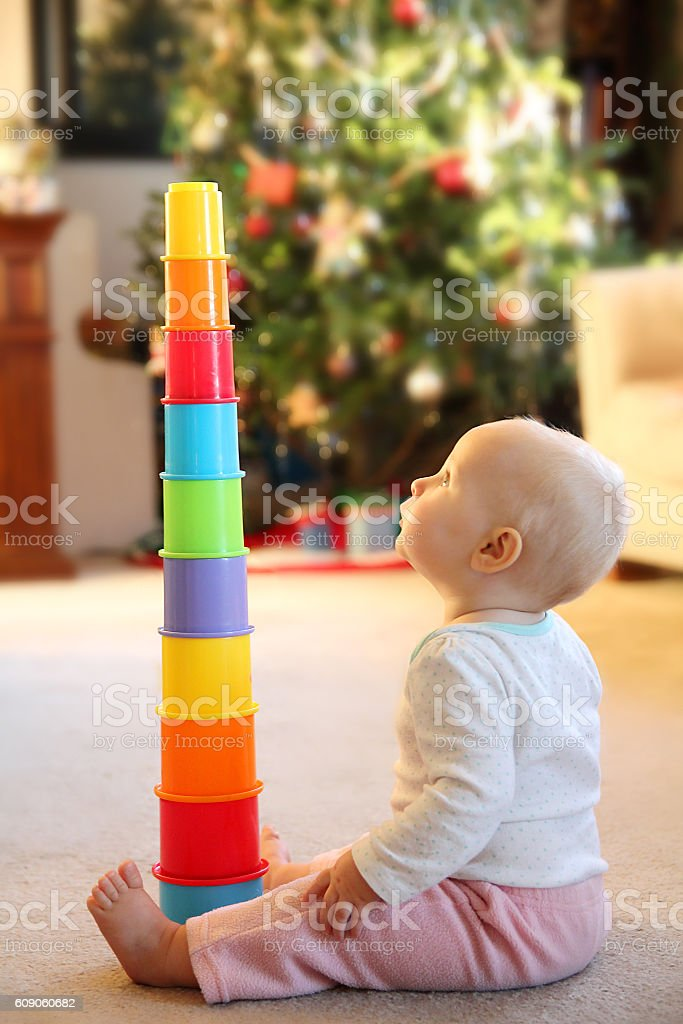 Baby Girl Playing with Stacking Cup Toy stock photo