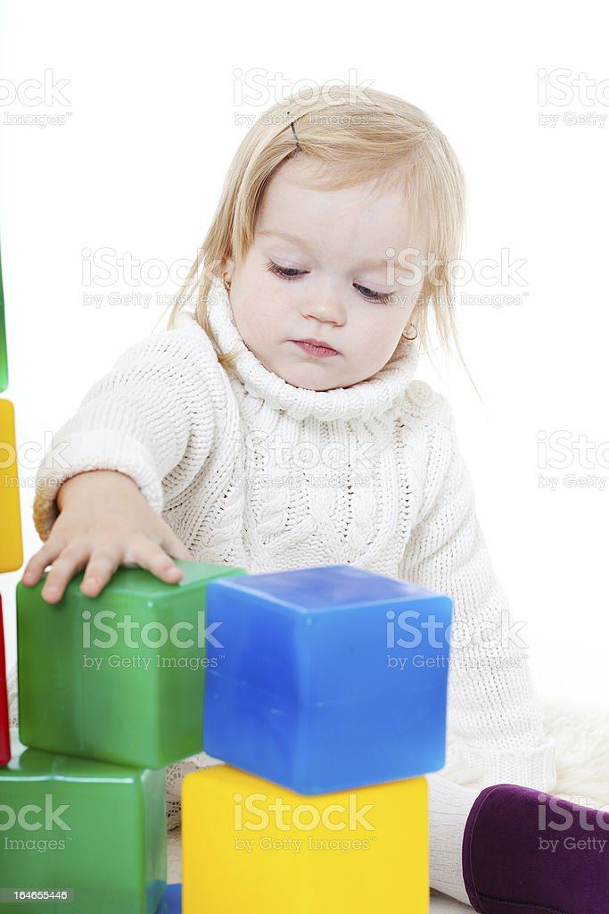 Baby girl plays with toy blocks royalty-free stock photo