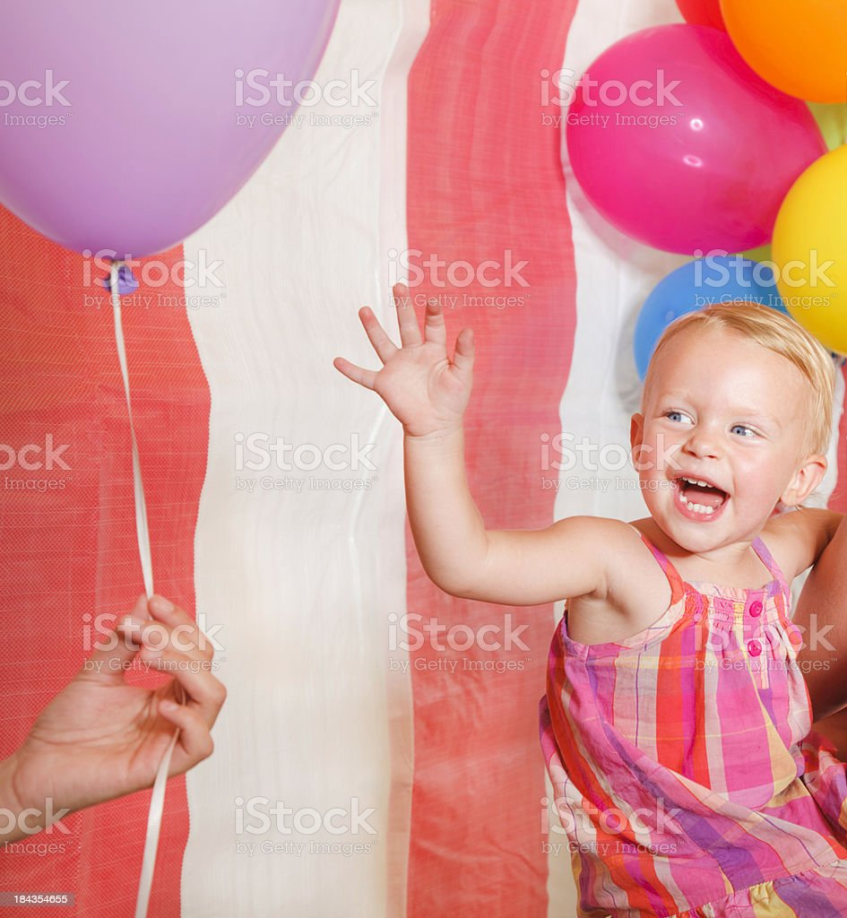 Baby Girl Reaching for Balloon royalty-free stock photo