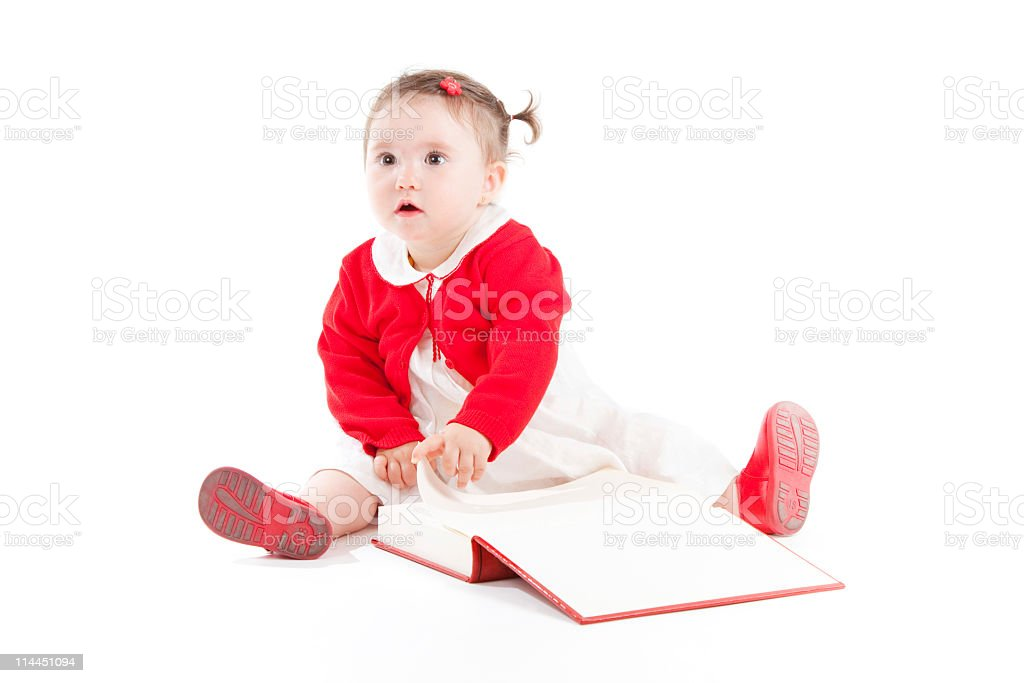 Baby girl reading a book. royalty-free stock photo