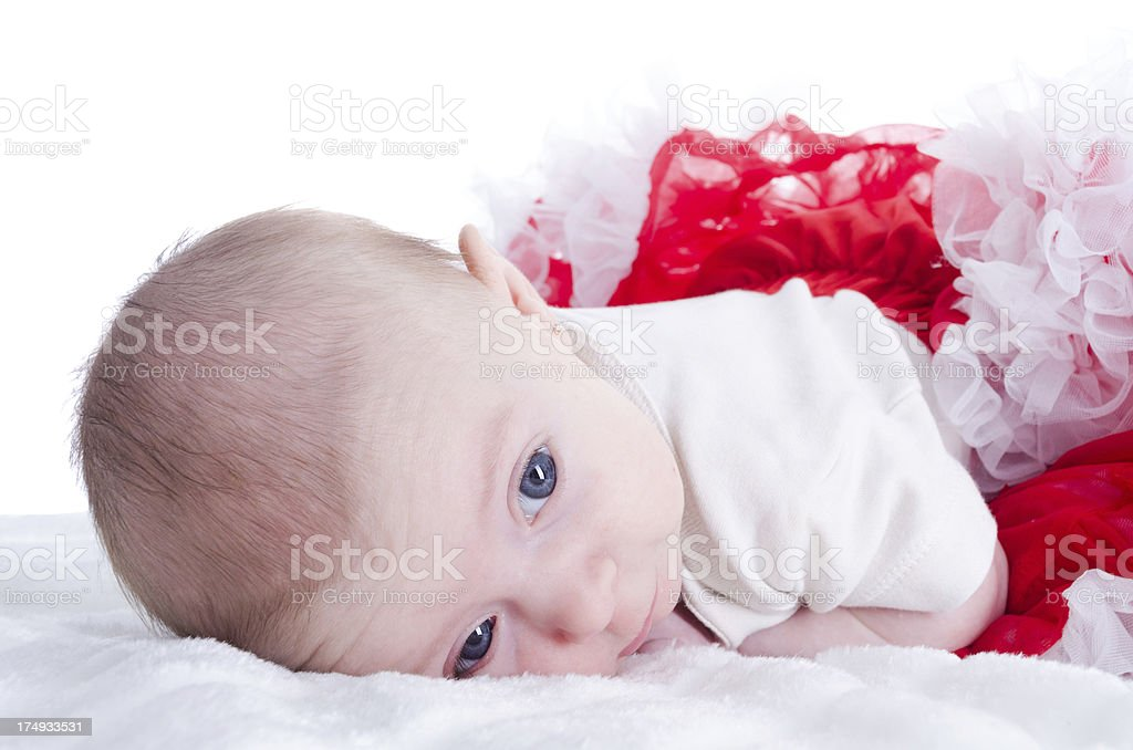 Baby girl resting on front. royalty-free stock photo