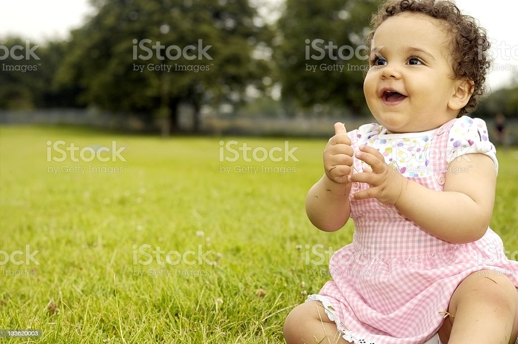 Baby Girl (1 year old) Sitting On Grass, Clapping Hands royalty-free stock photo
