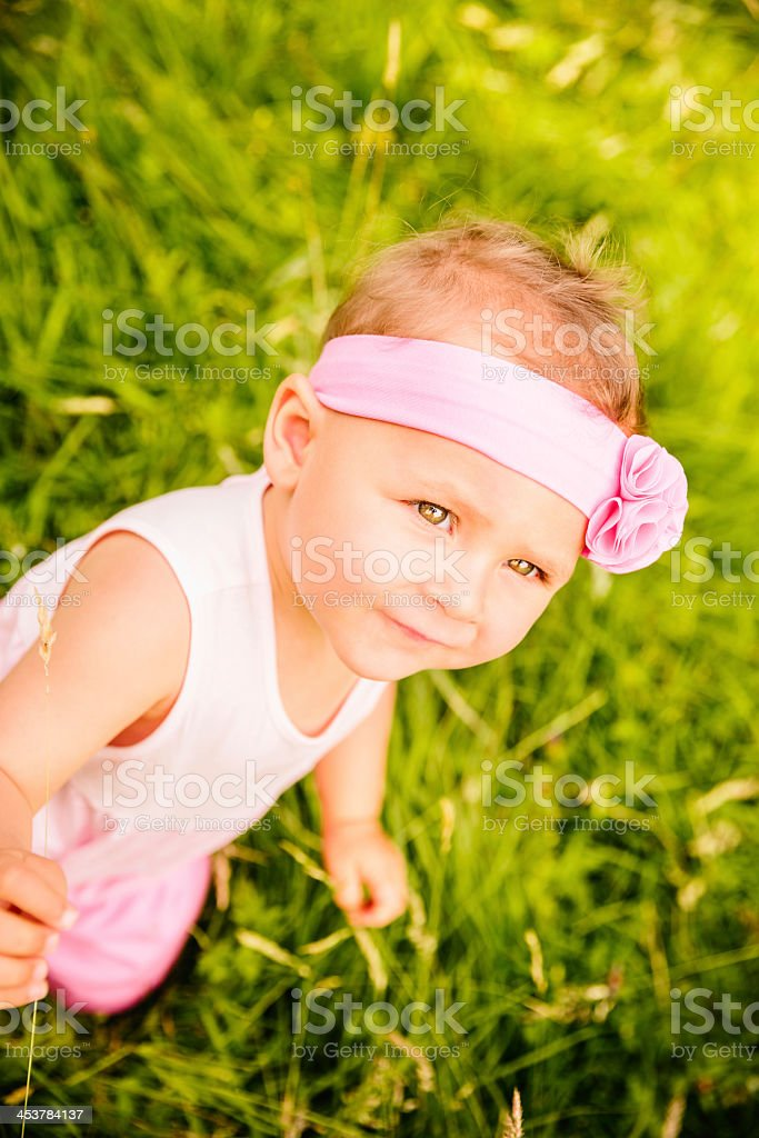 Baby girl sitting on grass royalty-free stock photo