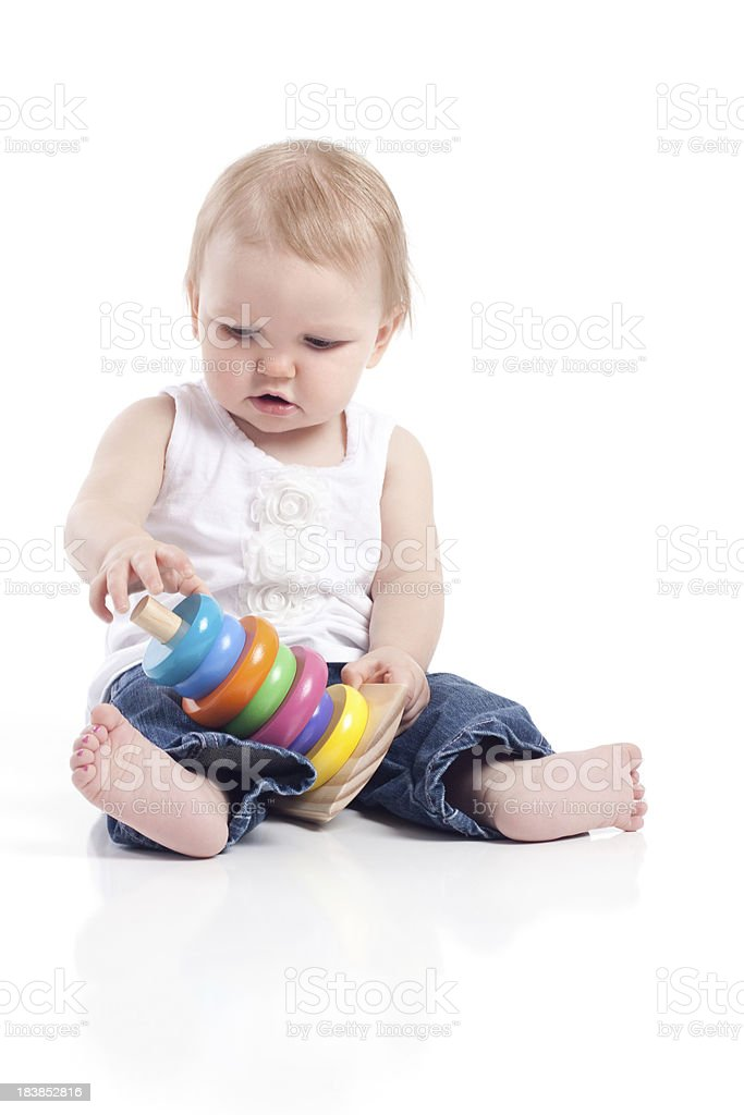 Baby Girl Sitting on White Background Playing with Toy royalty-free stock photo