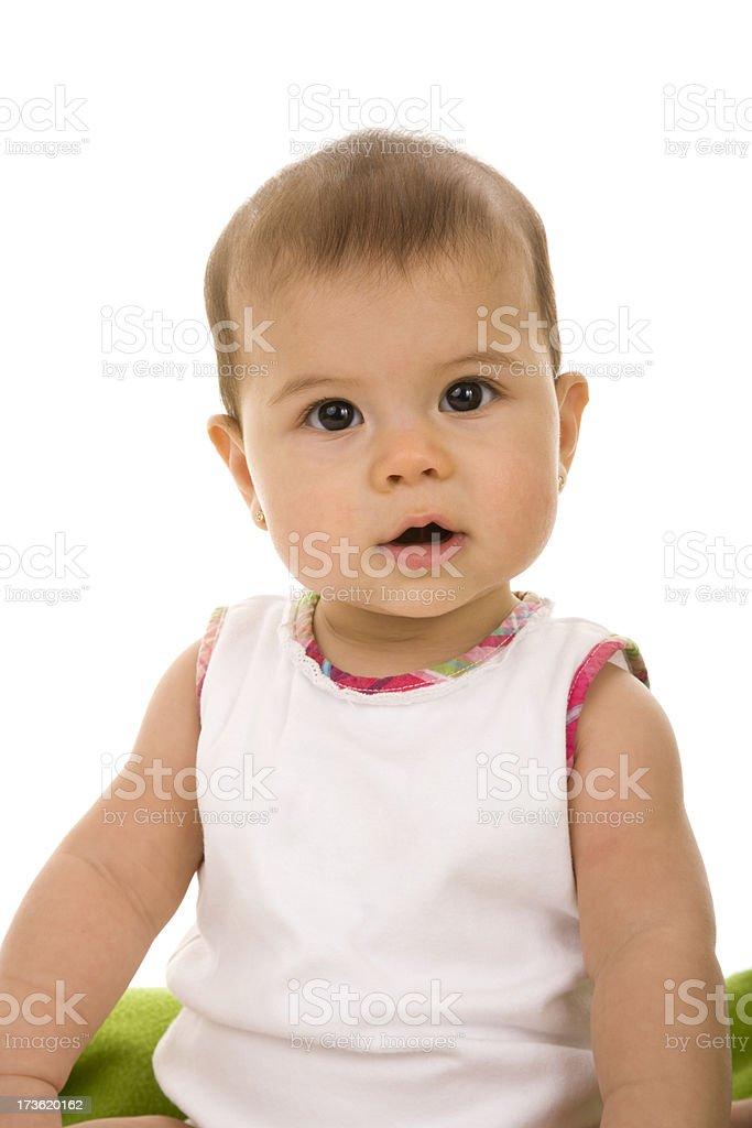 Baby girl sitting up looking at camera royalty-free stock photo