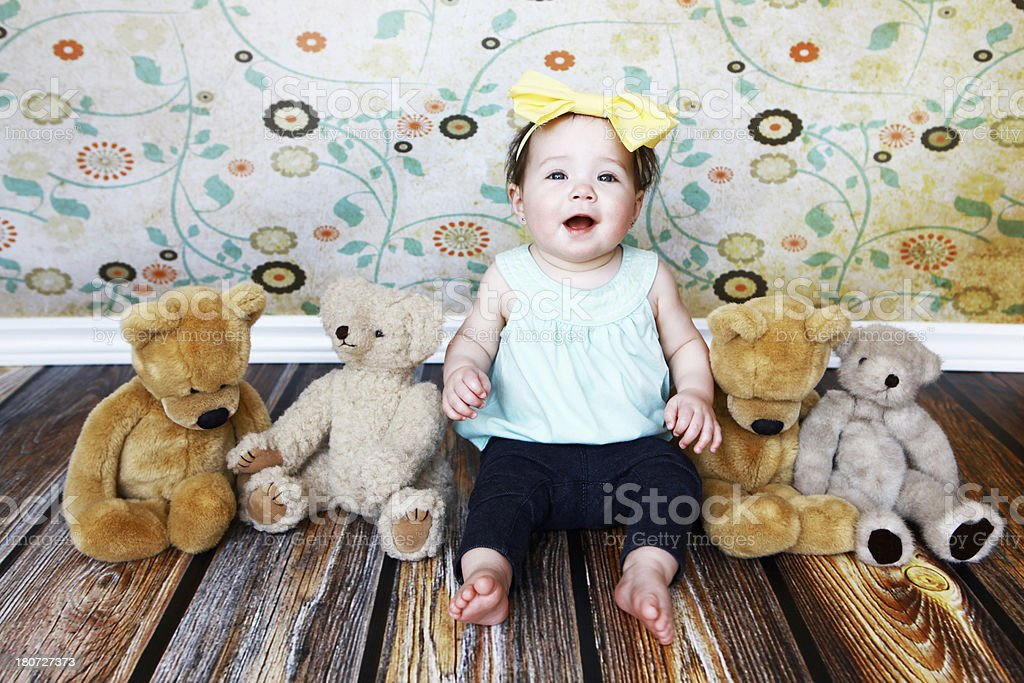Baby Girl Sitting with Teddy Bears royalty-free stock photo