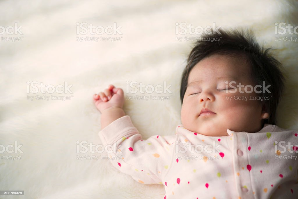 Baby girl sleeping at home. stock photo