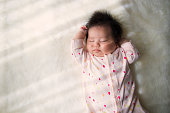 Baby girl sleeping at home.