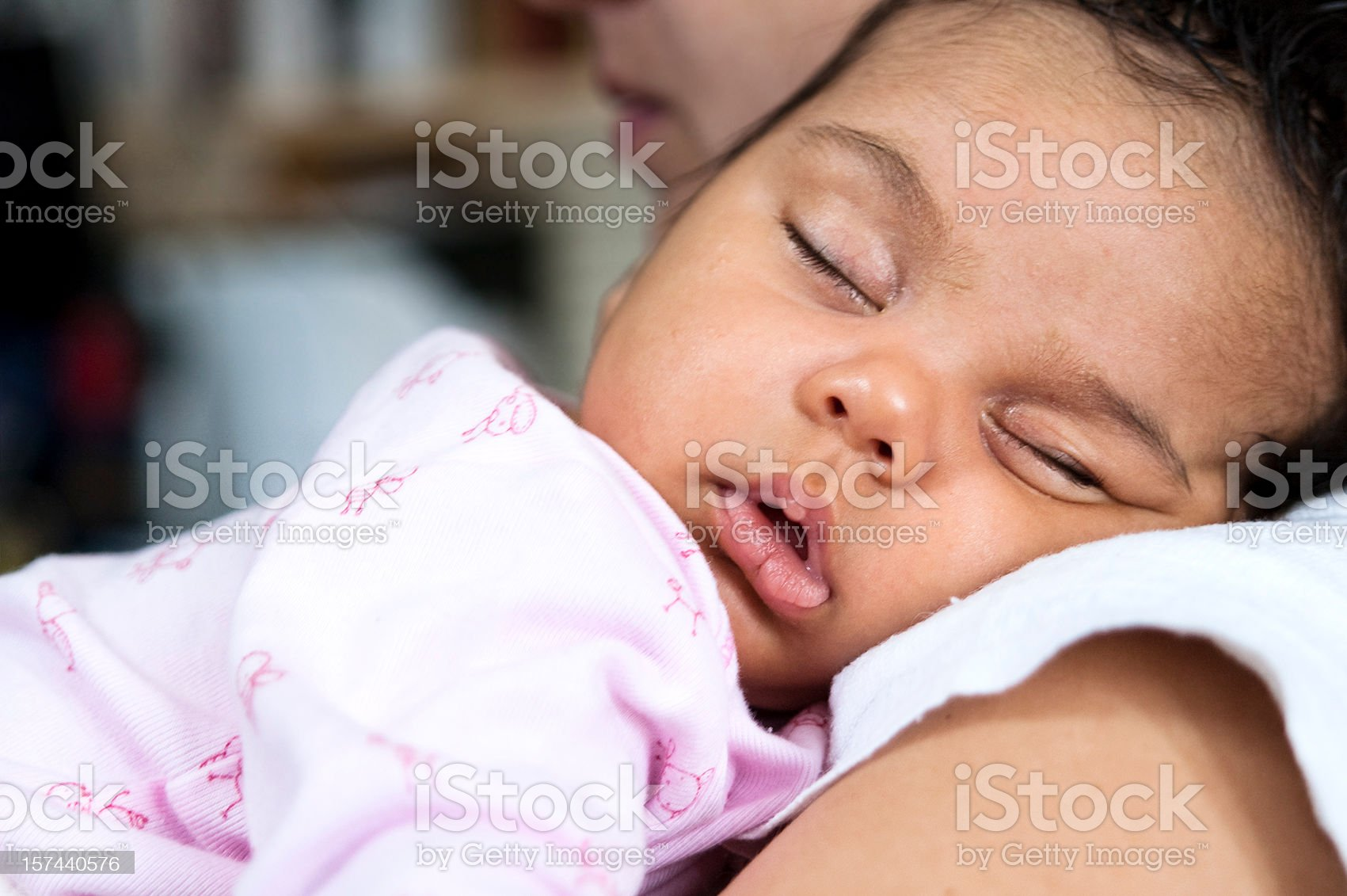 Baby Girl Sleeping on Her Mother Shoulders royalty-free stock photo