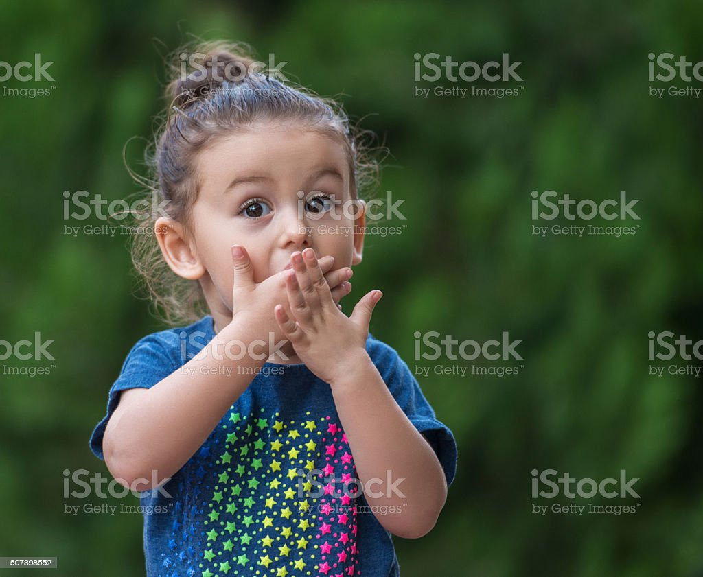 Baby girl standing with a shocked face stock photo