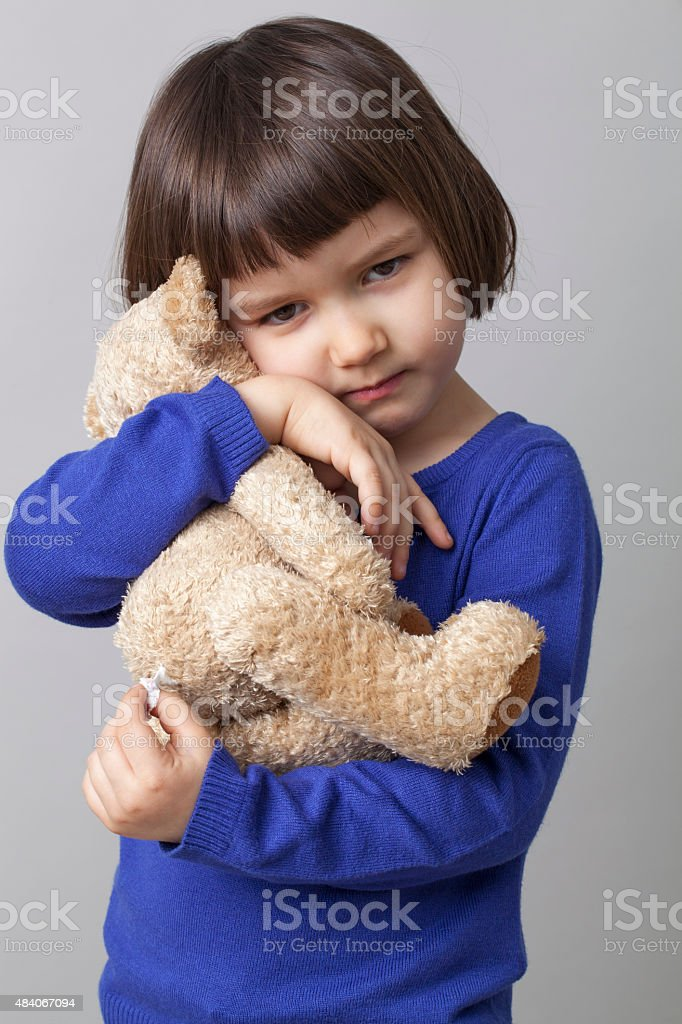 baby girl taking care of her teddy bear for happiness stock photo