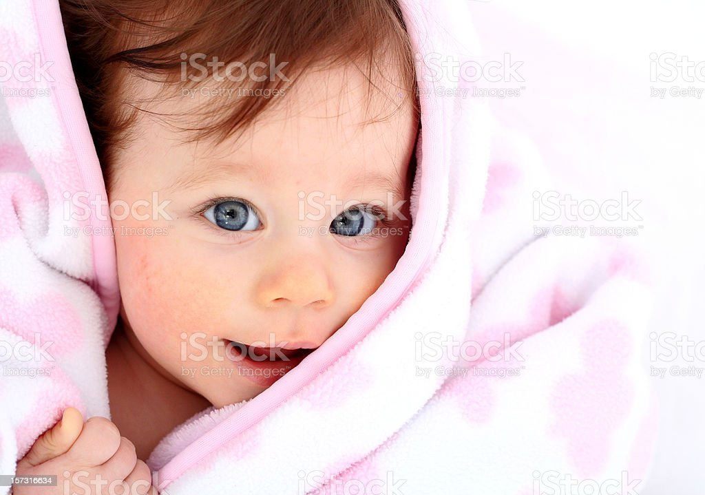 Baby girl under blanket royalty-free stock photo