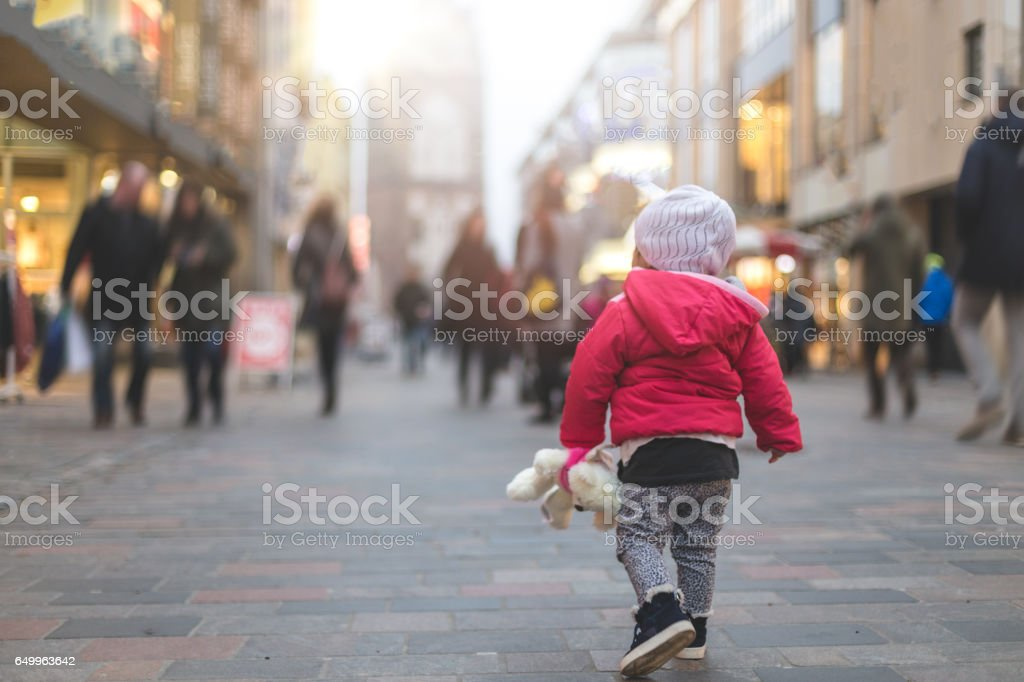 Baby girl walking in the city with her best friend stock photo