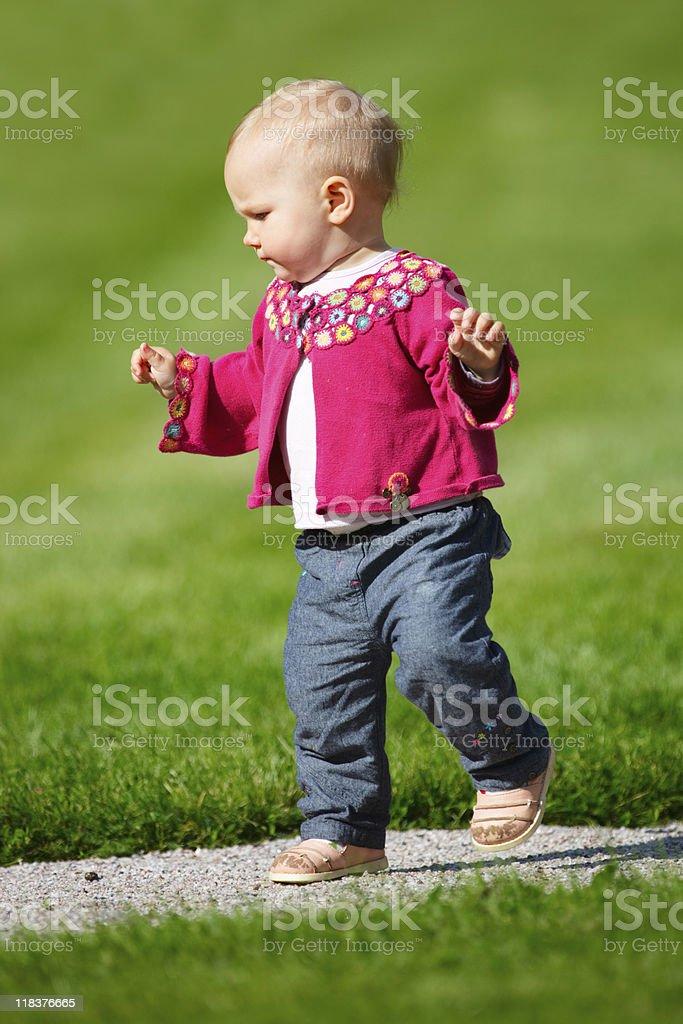 Baby girl walking stock photo