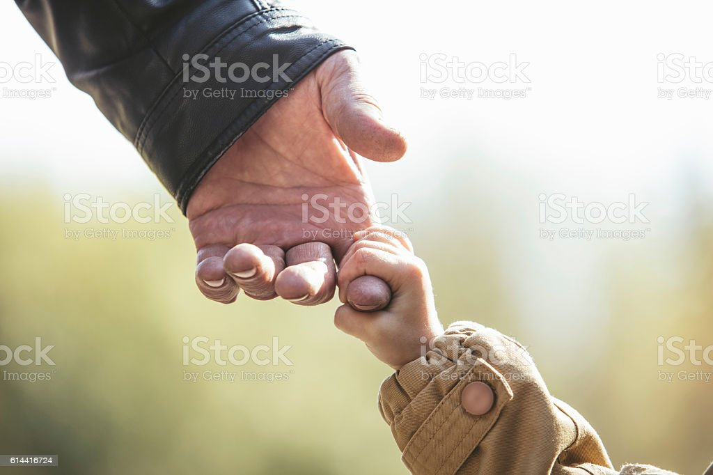 Baby girl warm jacket and cap c grandfather hands stock photo