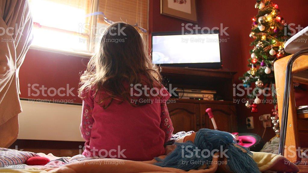 Baby Girl watching TV Screen stock photo