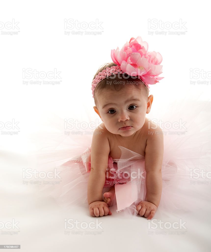 A baby girl wearing a pink tutu with a flower headband royalty-free stock photo