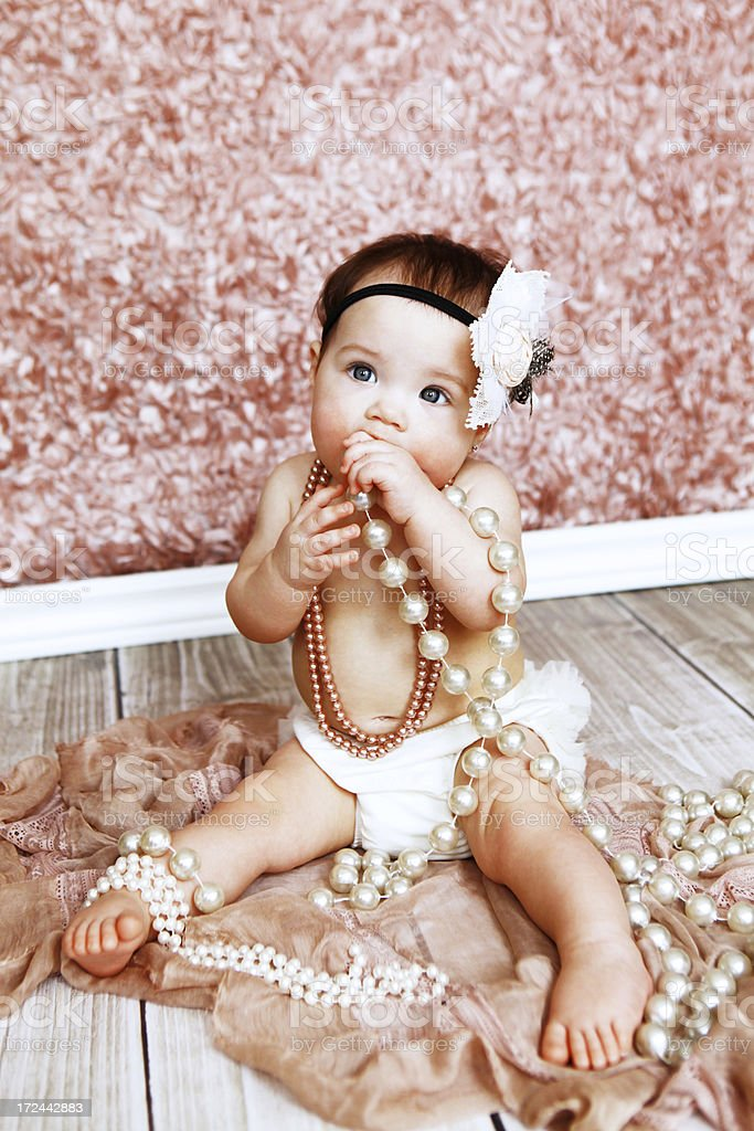 Baby Girl Wearing Pearls stock photo