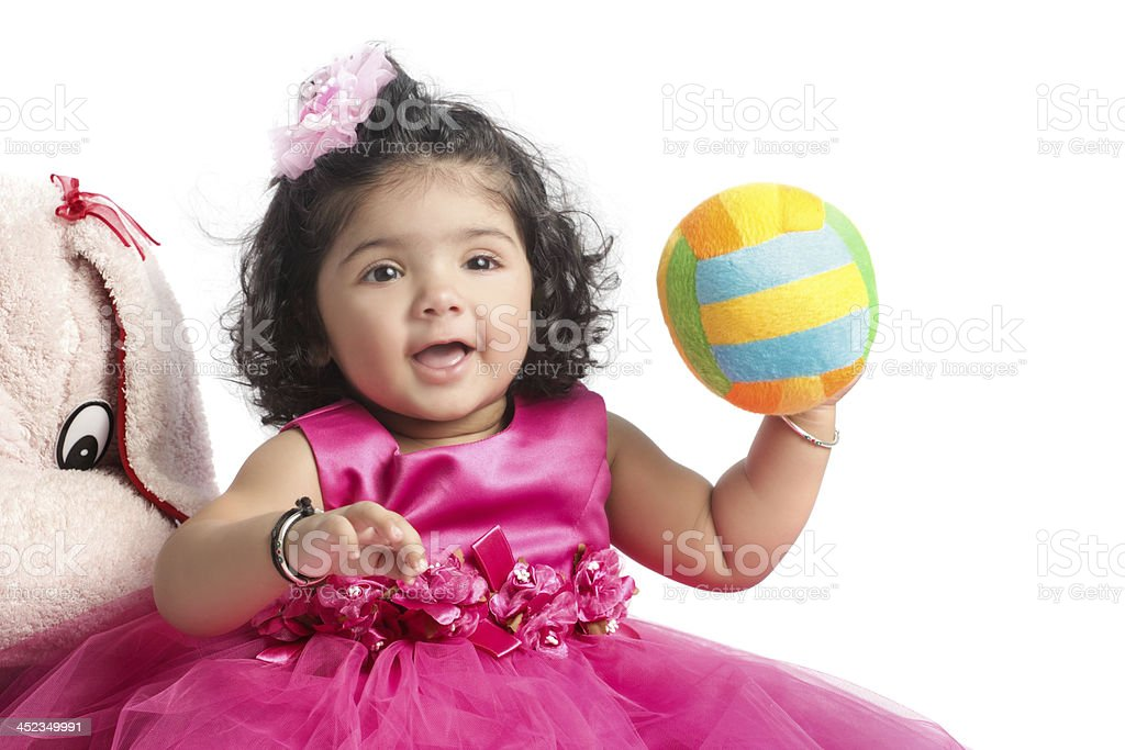Baby girl with a colored soft ball royalty-free stock photo