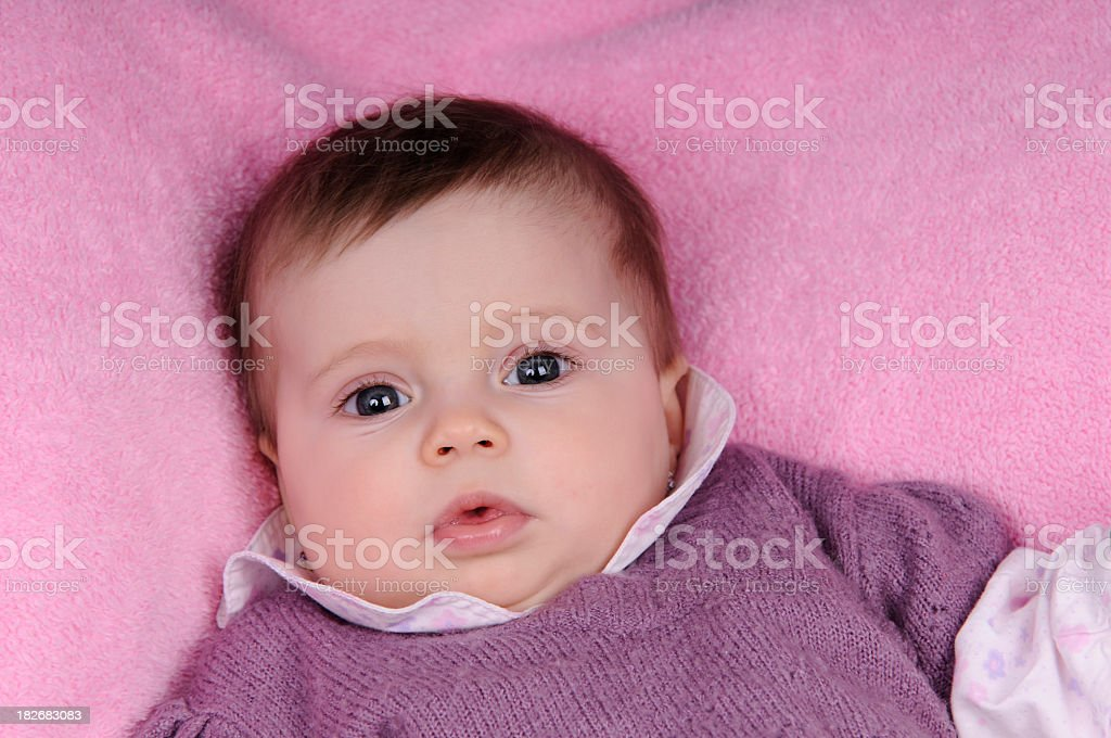 baby girl with a pink background royalty-free stock photo