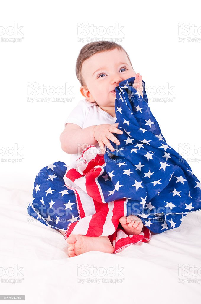 Baby girl with american flag. stock photo