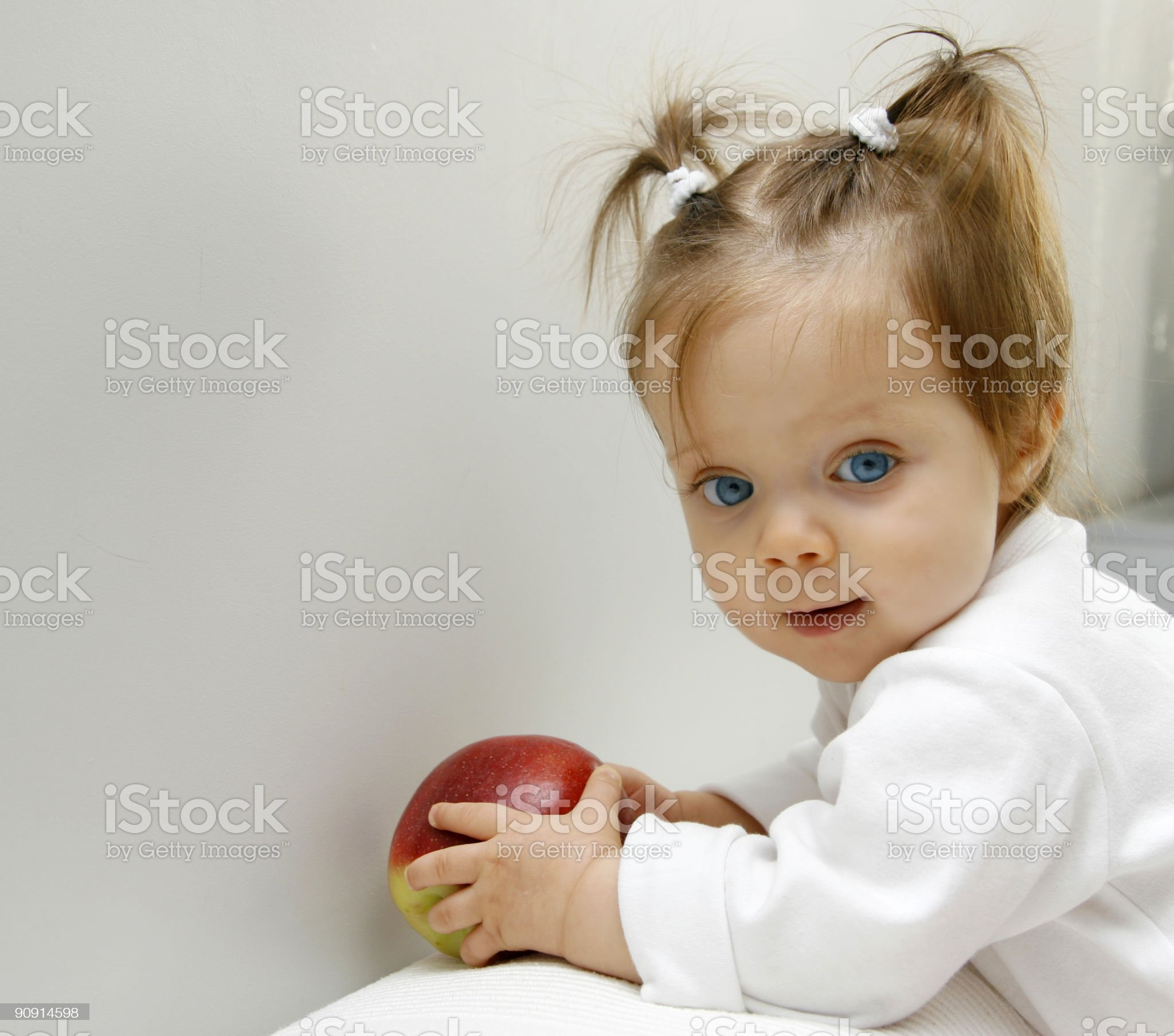 Baby girl with apple royalty-free stock photo