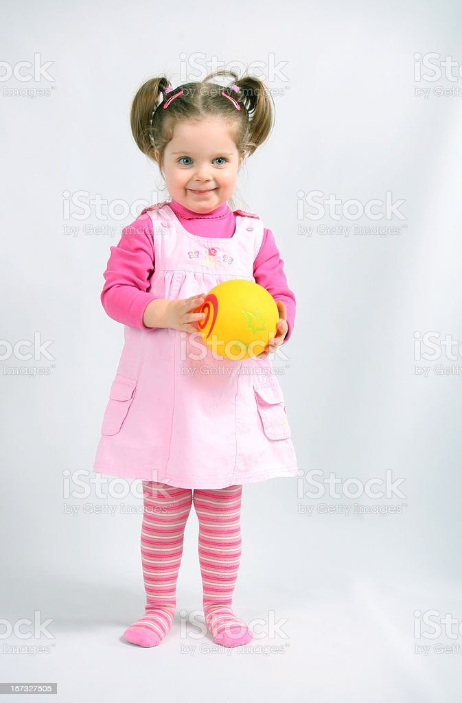 Baby girl with ball royalty-free stock photo