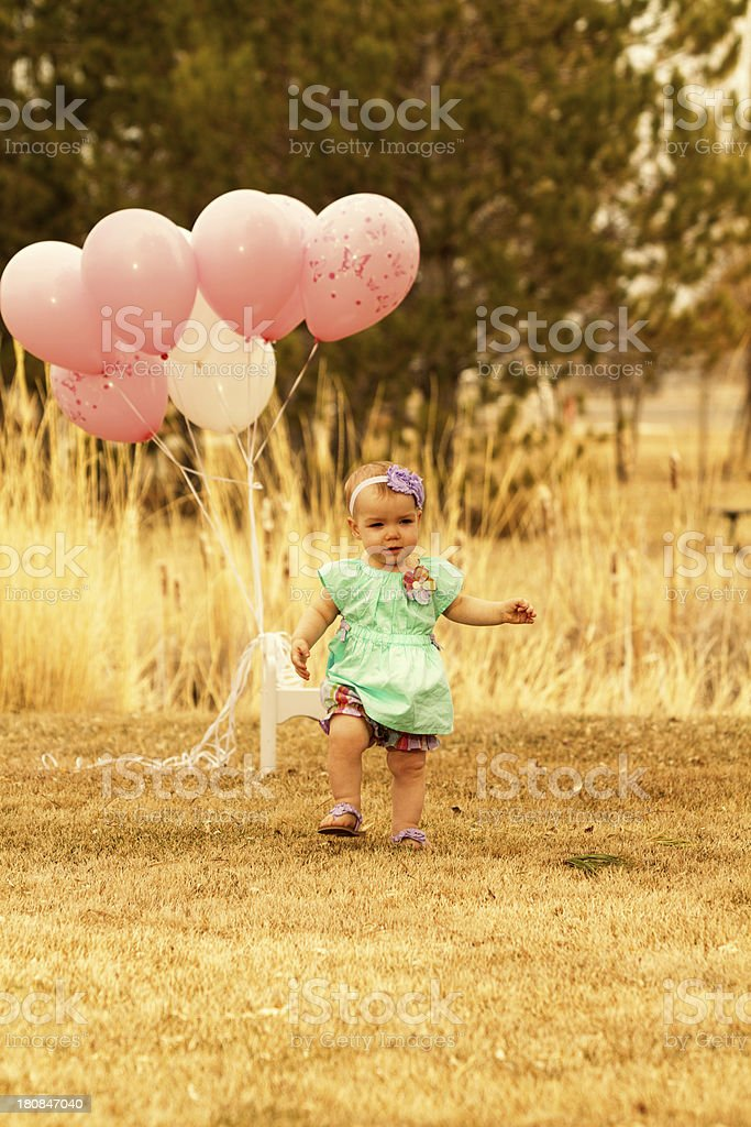 Baby girl with balloons royalty-free stock photo