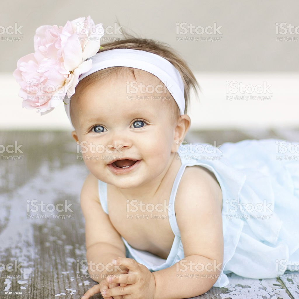 Baby Girl with big flower headband stock photo