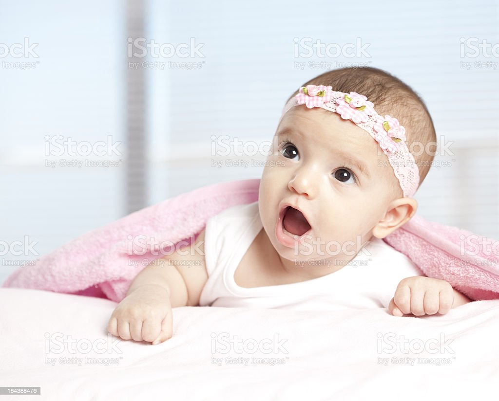 Baby girl with bow. stock photo