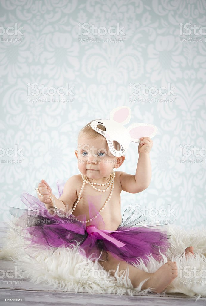 Baby girl with bunny mask royalty-free stock photo
