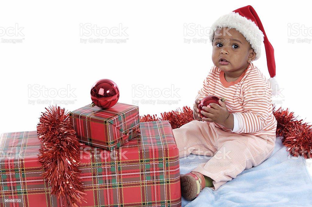 baby girl with christmas presents stock photo