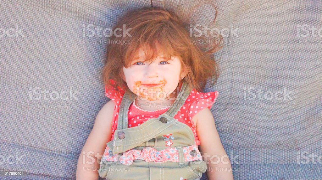 Baby girl with dirty mouth stock photo