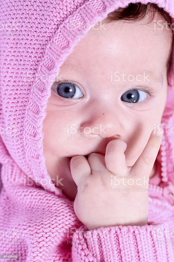 Baby girl with finger in mouth royalty-free stock photo