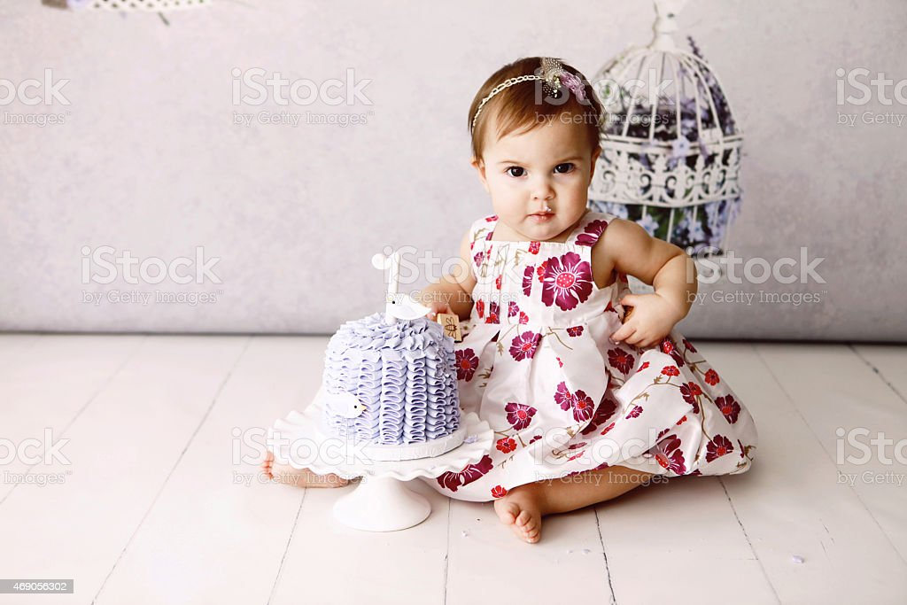 Baby Girl With First Birthday Cake stock photo