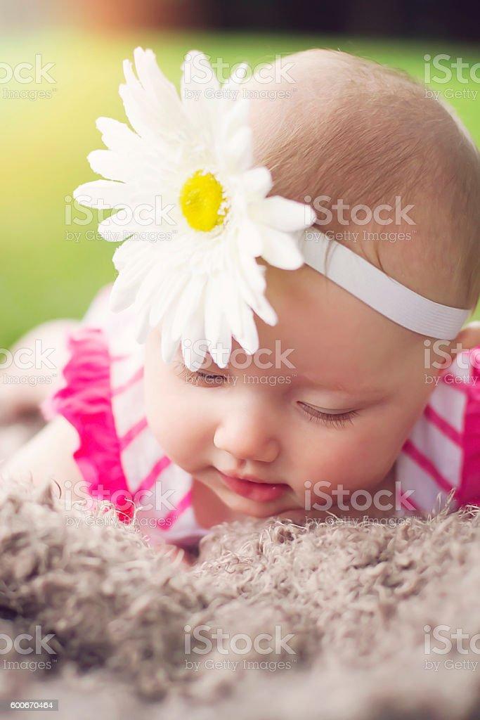 Baby Girl with Flower Headband stock photo